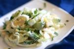 Салат из огурцов, сыра и яиц с маринованным луком